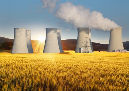nuclear plant: Nuclear power plant with yellow field and sun