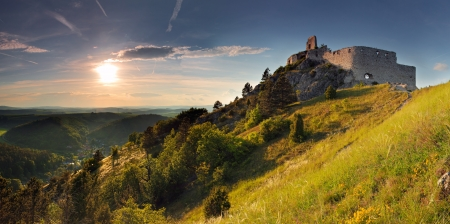 Ruin of castle with sun - Slovakia