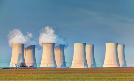 atomic energy: Nuclear power plant with clouds
