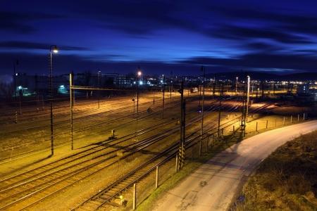 railroad station platform: Railway lines at night. Stock Photo