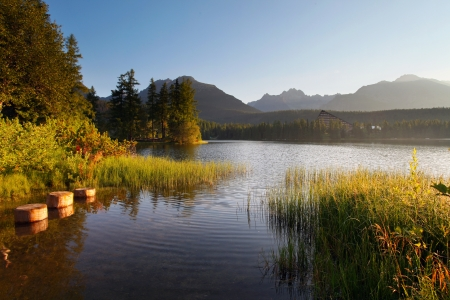 Mountain Lake in Slovakia Tatra - Strbske Pleso with dramatic clouds photo