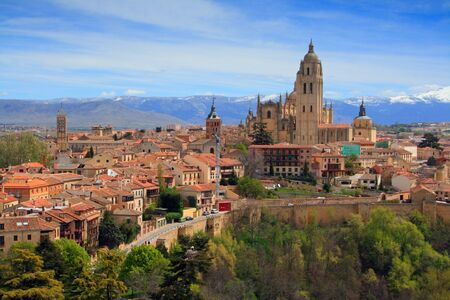The last Gothic cathedral built in world, in Segovia, In the background is the mountain Sierra de Guadarrama Spain photo