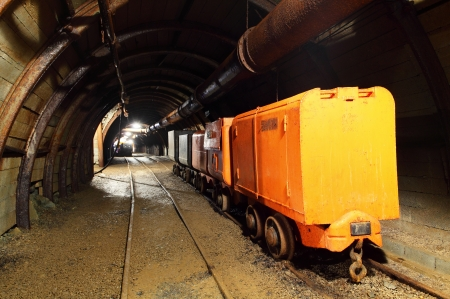 coal mine: Wagons and machine in gold, silver and cooper mine Stock Photo
