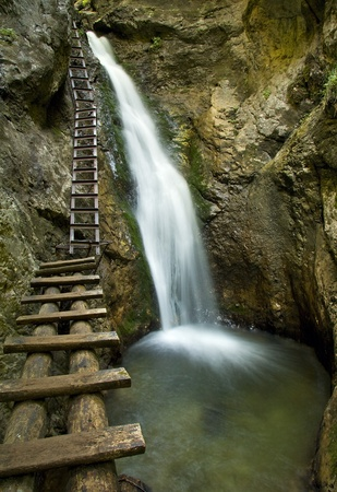 hot spring: Canyon with mountain creek and wooden ladder