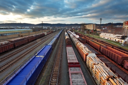 railway transportations: Freight Station with trains at sunset Stock Photo