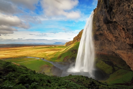 iceland: Seljalandsfoss is one of the most beautiful waterfalls on the Iceland  It is located on the South of the island  With a rainbow  Stock Photo