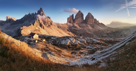 Dolomites mountain panorama in Italy at sunset - Tre Cime di Lavaredo photo