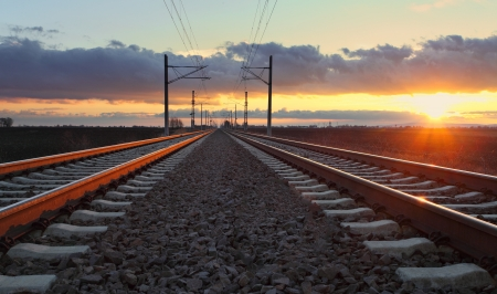 railroad station platform: Railway at dusk