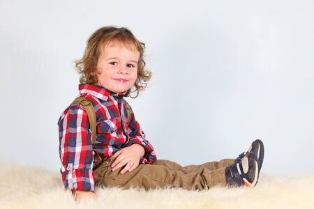 Little boy in rural clothes photo