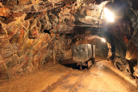 tunneling: Underground train in mine, carts in gold, silver and copper mine