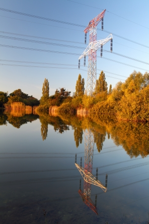 electricity substation: Electricity pylon with reflection in water