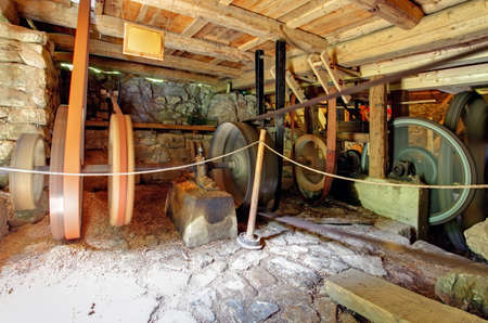gristmill: Interior of historic watermill Stock Photo
