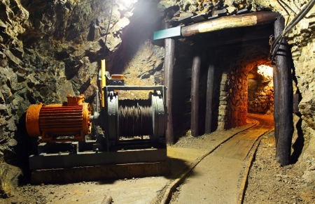 Historical gold, silver, copper mine with machine photo