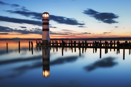lighthouse with beam: Lighthouse at Lake Neusiedl at night