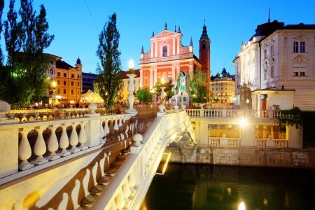 ljubljana: Ljubljana at night, with the Triple Bridge Slovenia Stock Photo