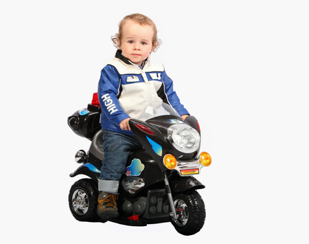 Little child on motorcycle photo