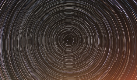 Cumulative time lapse of star trails in night sky. photo