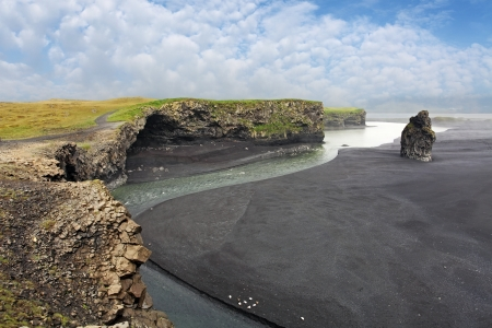 The black sand beach of Reynisfjara and the mount Reynisfjall from the Dyrholaey promontory in the southern coast of Iceland. photo