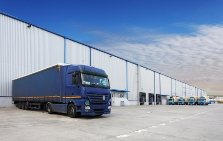 loading dock: Truck at warehouse building Stock Photo