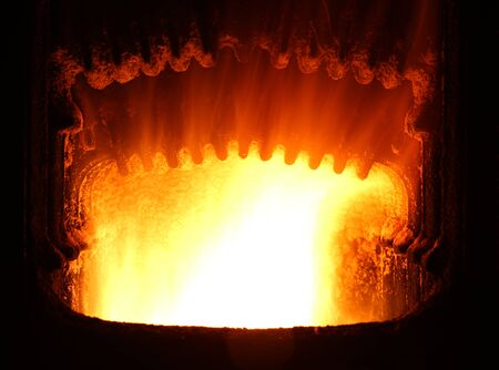 fuel chamber: Colorful fire in industrial furnace.