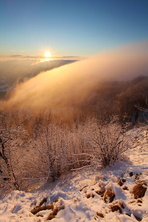 Winter sunset over the clouds photo