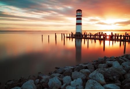 Landschap oceaan zonsondergang - vuurtoren Stockfoto