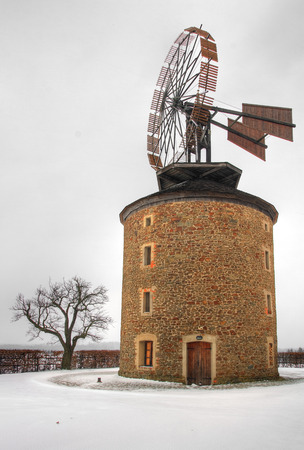 Ancient stone wind mill photo