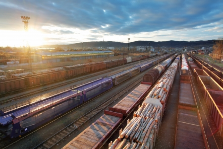 railtrack: Railway at sunset with cargo trains. Stock Photo