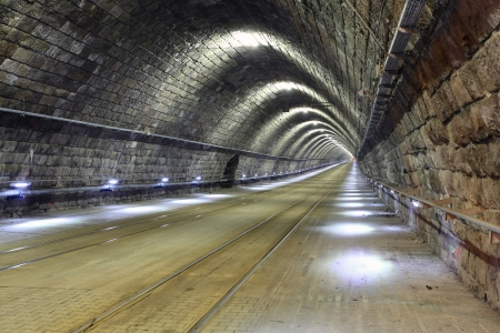 blur subway: A tram disappearing into a tunnel