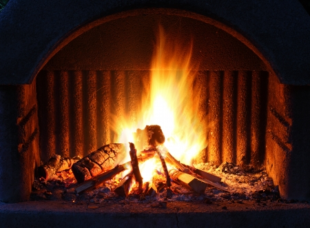 outdoor fireplace: Fireplace with fire at night - outdoor shot