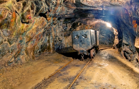 Underground mine with truck and railroad photo