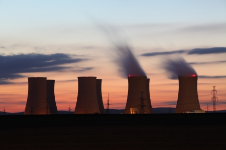 Nuclear power plant by sunset photo