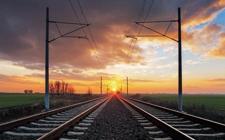 sun track: Railroad at a dramatic sunset
