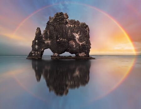 Colorful Rainbow over a ocean rock, Iceland photo