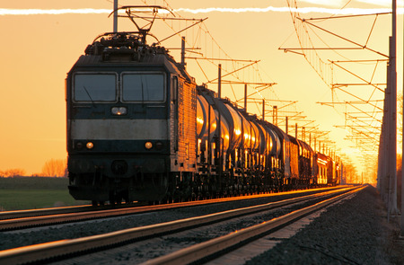 goods train: Train cargo in railroad at a sunset Stock Photo