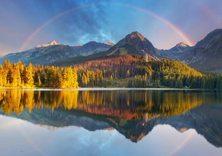 Mountain lake landscape with rainbow - Slovakia, Strbske pleso photo