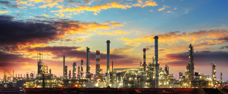 Oil refinery industrial plant at night photo