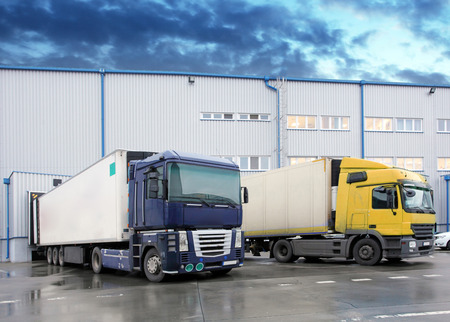 commercial docks: Unloading cargo truck at warehouse building