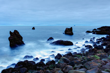 Rocky coast near Reykjanes, Iceland photo