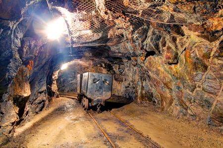 Railroad mine tunnel in a dark underground photo