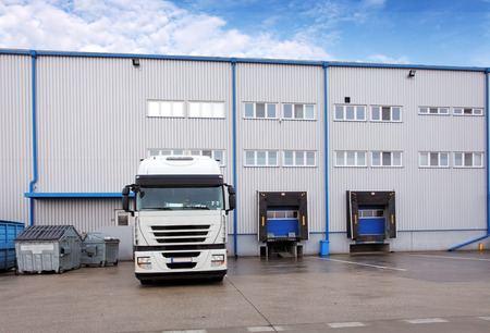 warehouse building: Shipping cargo truck at warehouse building