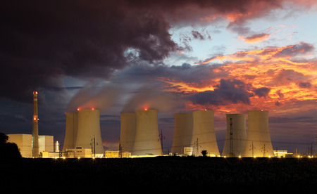 Nuclear power plant by night photo