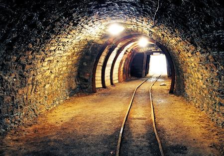 coal mining: Mine gold underground tunnel railroad Stock Photo