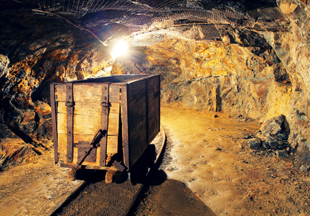 Mining cart in silver, gold, copper mine photo
