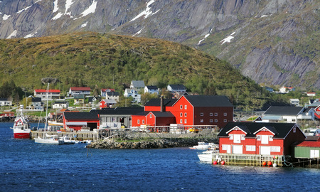 Norway village Reine with red house photo