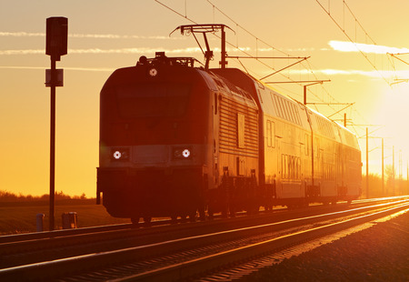 Train cargo in railroad at a sunset photo