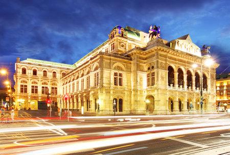 Vienna state opera at night with traffic
