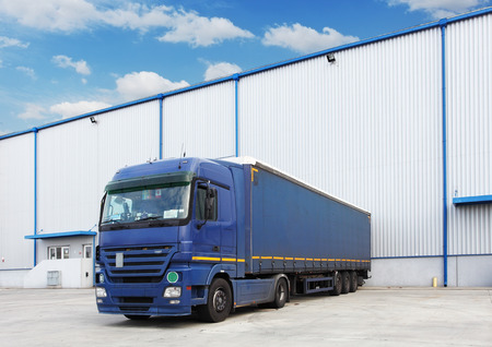 loading bay: Truck at warehouse building Stock Photo