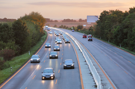 highway at night: Cars on highway road at sunset