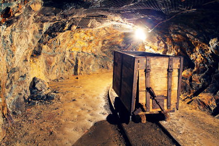 COAL MINER: Mine gold underground tunnel railroad Stock Photo